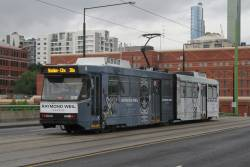 B2.2015 advertising 'Raymond Weil' heads east on route 30 over the La Trobe Street bridge