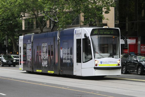 D1.3502 advertising 'Bank of Melbourne' heads north on route 58 at William and Little Lonsdale Street