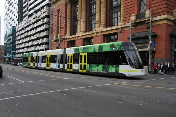 E.6004 heads south at Spencer and Bourke Street on a test run