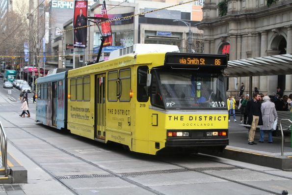 B2.2119 advertising 'The District Docklands' eastbound on route 86 at Bourke and Elizabeth Street