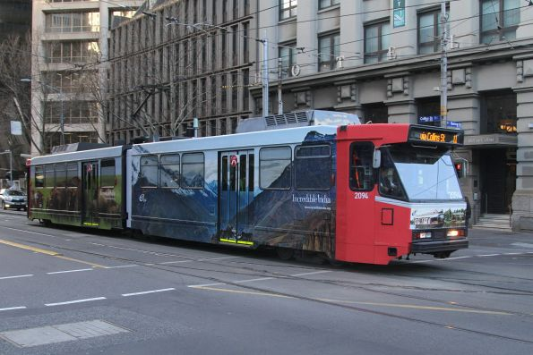 B2.2094 advertising 'Amazing India' heads west on route 11 at Collins and Spencer Street