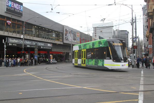 E2.6054 turns from Spencer into Bourke Street on route 86