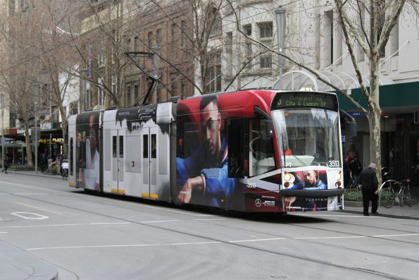 D1.3513 advertising 'Tommy Hilfiger' heads north on route 6 at Swanston and Bourke Street