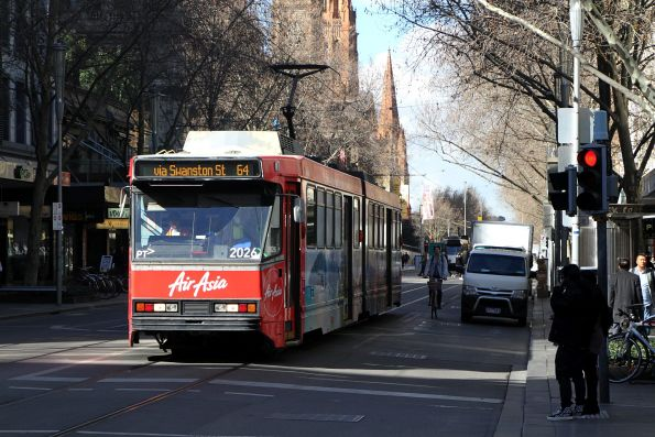 B2.2026 advertising 'Air Asia' heads north on route 64 at Swanston and Bourke Street