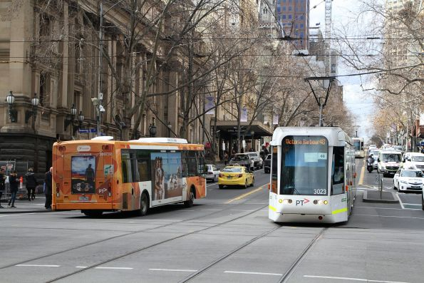 C.3023 on route 48 passes Transdev bus #732 1732AO at Collins and Swanston Street