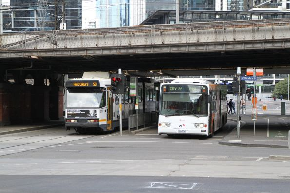 B2.2059 on route 58 passes Transdev bus #353 0353AO on route 220 at Market and Flinders Street