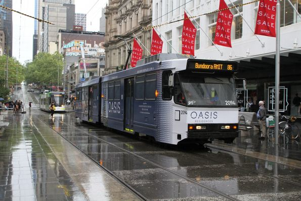 B2.2094 advertising 'Oasis Apartments' heads east on route 86 in the Bourke Street Mall