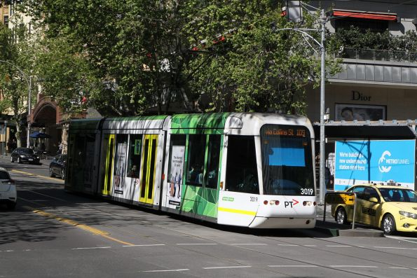 C.3019 heads west on route 109 at Collins and Swanston Street