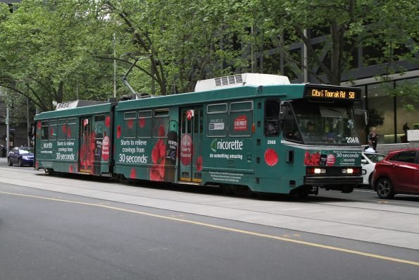 B2.2068 advertising 'Nicorette' heads south on route 58 at William and Bourke Street