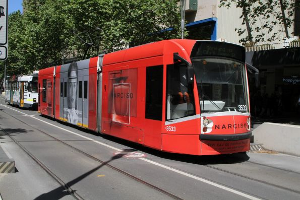 D1.3533 advertising 'Narciso' heads north on route 6 at Swanston and Collins Street