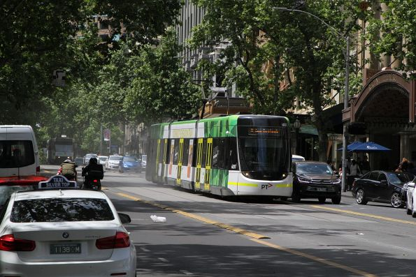 E.6001 heads west on route 11 at Collins and Swanston Street