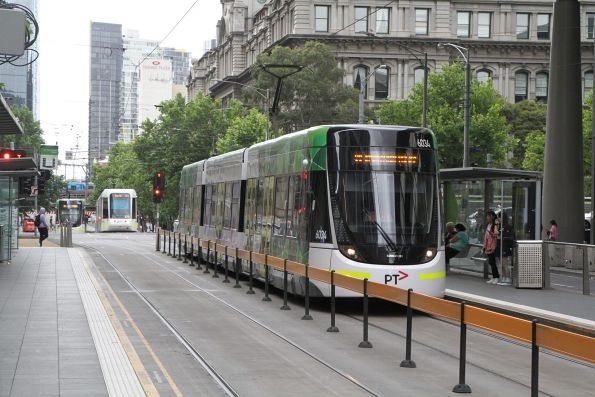 E.6034 heads north on a route 96 service at Spencer and Collins Street