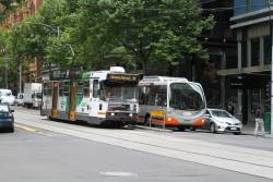 A2.280 westbound on route 48 beside Transdev bus #657 7280AO on route 235 at Collins and King Street