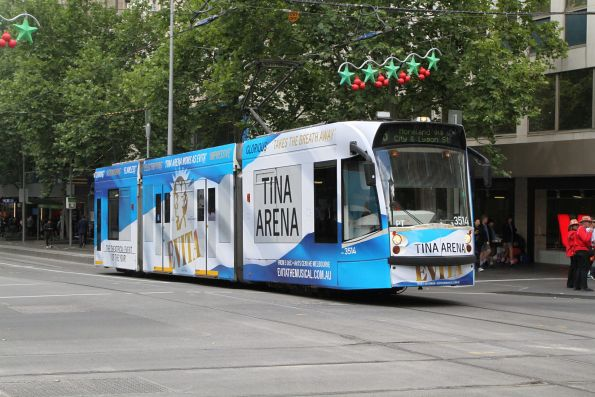 D1.3514 advertising 'Evita the Musical' heads north on route 6 at Swanston and Collins Street