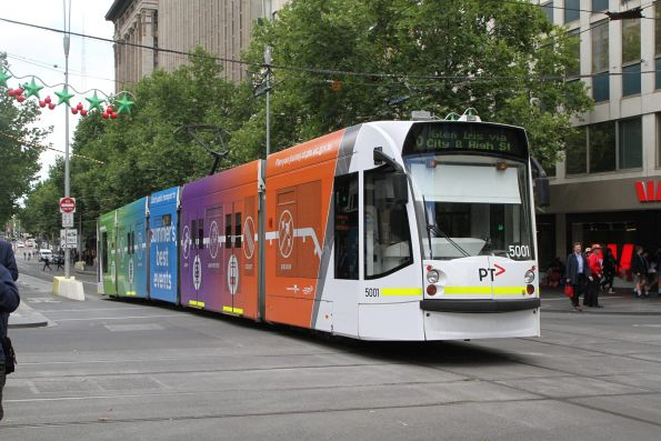 D2.5001 advertising 'Summers Best Events' for PTV heads south on route 6 at Swanston and Collins Street