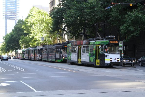 Z3.144 leads three more southbound route 58 trams stopped at William and Bourke Street