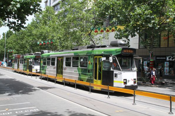 Z3.229 on route 16 and Z3.211 on route 1 head north at Swanston and La Trobe Street