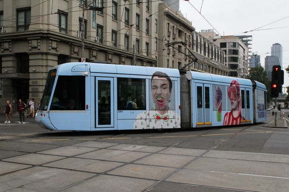 C.3001 advertising 'Slurpee' turns from Spencer into Collins Street on route 109