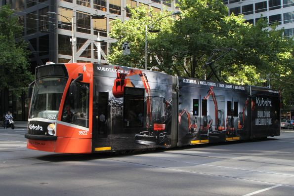 D1.3522 advertising 'Kubota' heads north on route 58 at William and Bourke Street