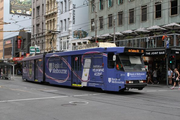 B2.2111 advertising 'Bank of Melbourne' heads north on route 19 at Elizabeth Street and Flinders Lane
