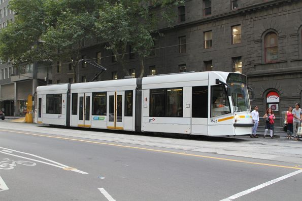 Bare white liveried D1.3522 heads south on route 58 at William and Bourke Street