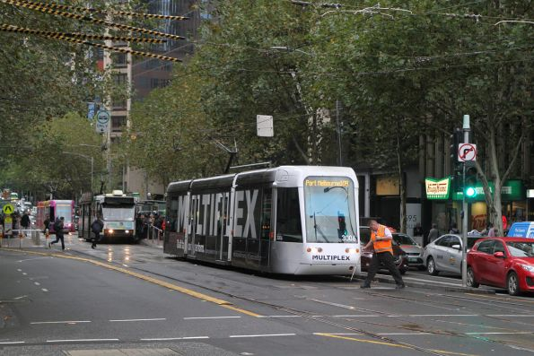 Yarra Trams operations staff throw the points for C.3006 headed west on route 109 at Collins and Spencer Street