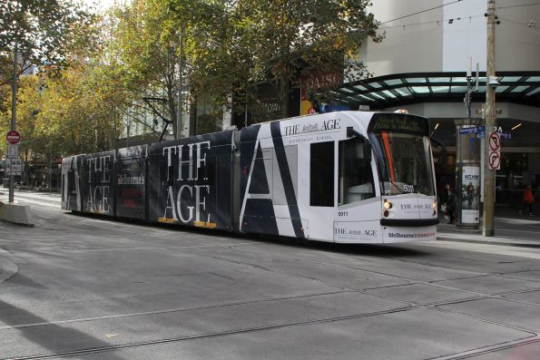 D2.5011 advertising 'The Age' heads south on route 6 at Swanston and Bourke Street