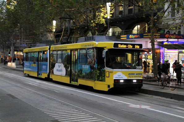 B2.2037 advertising 'Cebu Pacific' heads north on route 64a at Swanston and Collins Street