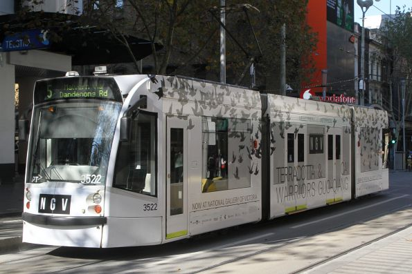 D1.3522 advertising the 'Terracotta Warriors & Cai Guo-Qiang' NGV exhibition, headed south on route 5 at Swanston and Bourke Street