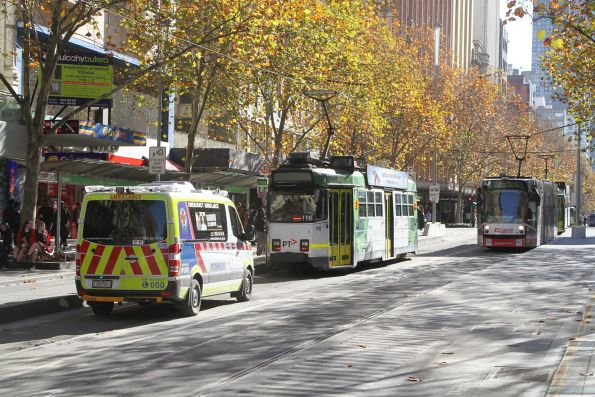 Ambulance dodges stopped trams at Swanston and Collins Street