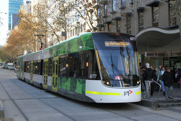 E2.6077 heads west on route 86 at Bourke and Swanston Street