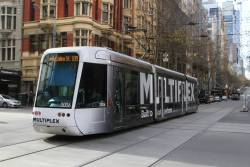 C.3006 advertising 'Multiplex' heads east on route 109 at Collins and Elizabeth Street