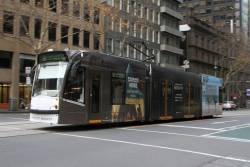 D1.3506 advertising 'Marriott Bonvoy' heads north on route 58 at William and Little Bourke Street
