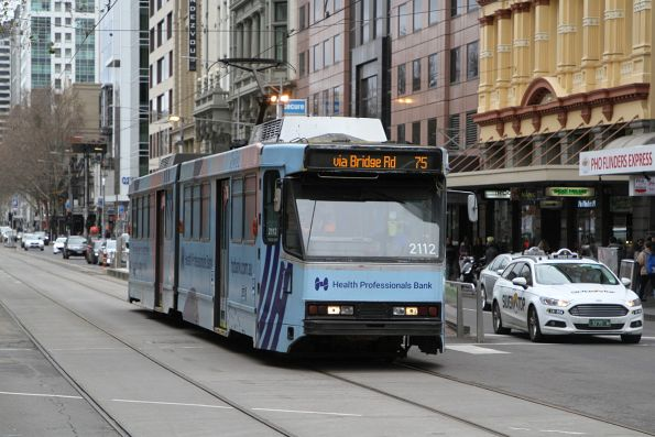 B2.2112 advertising 'Health Professionals Bank' heads east on route 57 at Flinders and Elizabeth Street