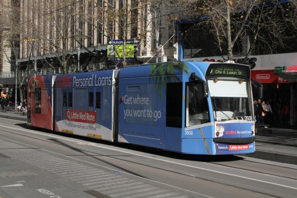 D1.3508 advertising 'Coles Personal Loans' heads north on route 6 at Swanston and Collins Street