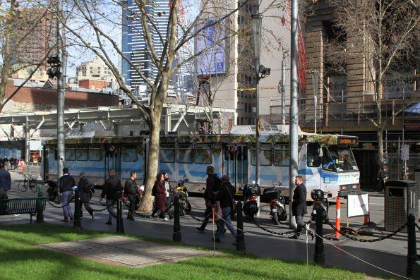B2.2103 advertising 'Noosa' heads south on route 64 at Swanston Street and Flinders Lane