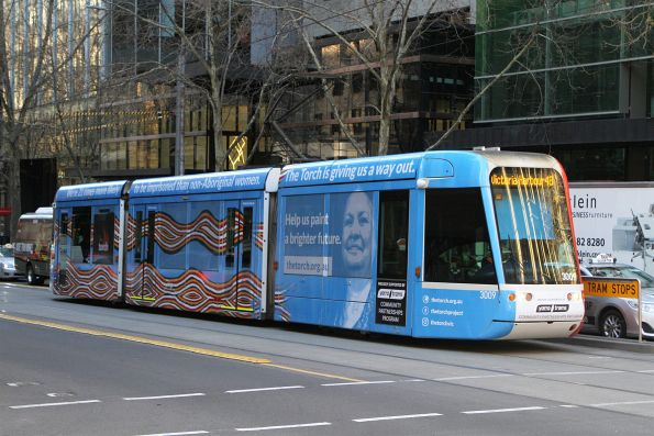 C.3009 advertising The Torch' heads west on route 109 at Collins and Queen Street