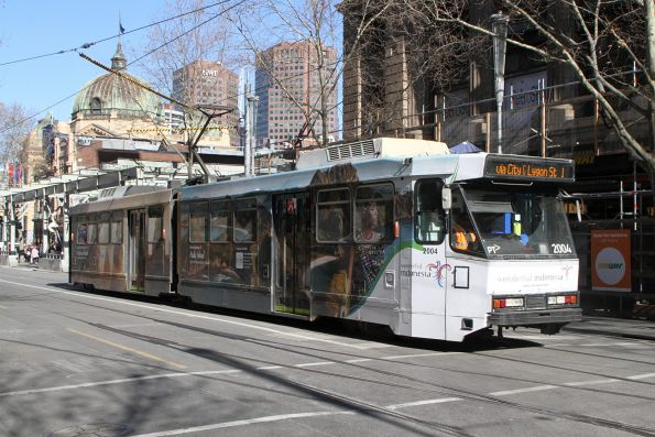 B2.2004 advertising 'Tourism Indonesia heads north on route 1 at Swanston Street and Flinders Lane