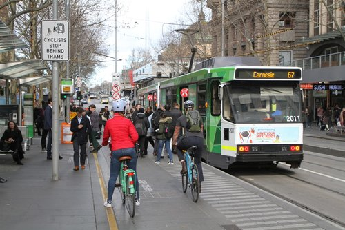 Cyclists stop for route 67 passengers boarding B2.2011 at Swanston and Collins Street