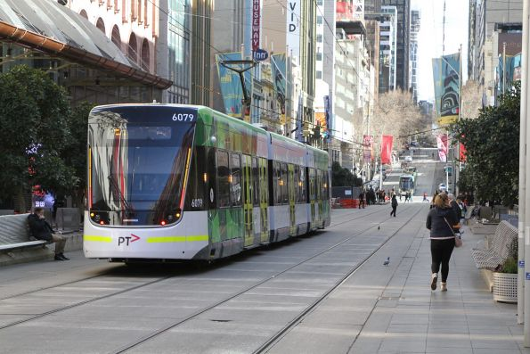 E2.6079 heads west on route 96 at Bourke and Swanston Street