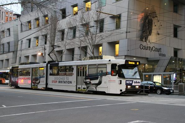 B2.2064 advertising 'Gillette' heads south on route 58 at William and Lonsdale Street