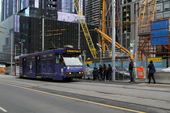 A1.242 advertising 'Bank of Melbourne' heads east on route 30 at La Trobe and Swanston Street