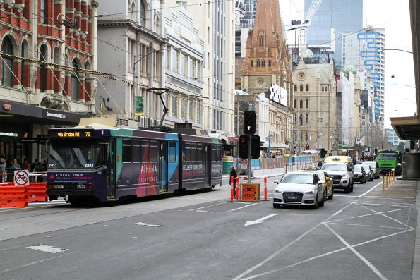 B2.2093 advertising 'Athena' heads east on route 75 at Flinders and Elizabeth Street
