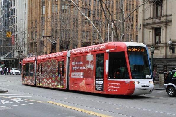 C.3009 advertising 'The Torch' heads east on route 109 at Collins and Swanston Street