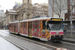 B2.2022 advertising 'Amplify Kombucha' heads south on route 64 at Swanston and Collins Street