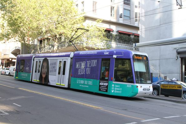 C.3025 advertising 'ASRC' heads west on route 48 at Collins and Swanston Street