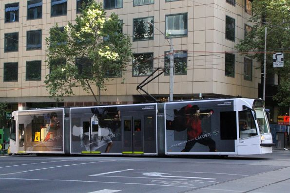 D1.3501 advertising 'Lacoste' heads north on route 58 at William and Collins Street