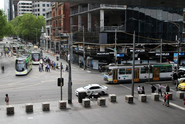 A1.258 heads north on Spencer Street past four E class trams on Bourke Street