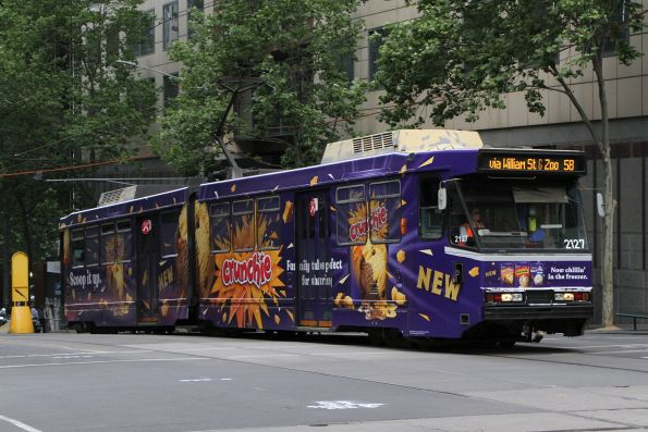 B2.2127 advertising 'Cadbury' heads north on route 58 at William and Collins Street