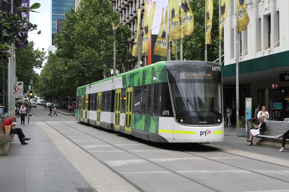E2.6075 heads west on route 96 at Bourke and Swanston Street